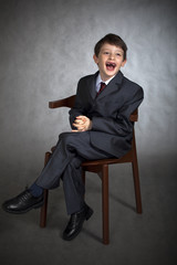 Studio portrait of funny boy dressed in suit