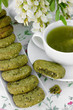 Green tea and cookies with green powder matcha