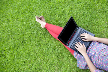 Female using laptop outdoor