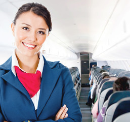 Flight attendant in an airplane
