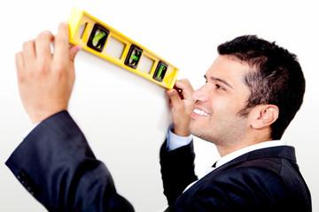 Man holding level instrument