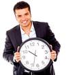 Business man holding a clock