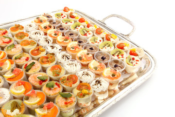 Appetizer (Canape) of shrimps and other selection food on tray