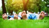 feet on grass. Family picnic in spring park - Fine Art prints