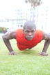 portrait of an African American athlete doing pushups