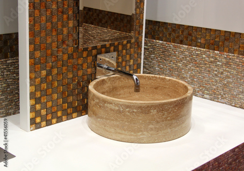 Stone washbasin and chrome tap - 41556059