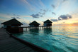 maldivian houses on sunrise