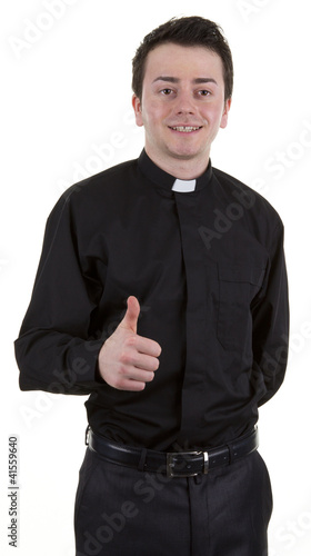 Priest with a thumbs up sign