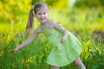 Cute little girl with field flowers