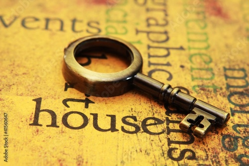 Old key on house text