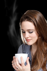 Young Woman Enjoying a Hot Beverage