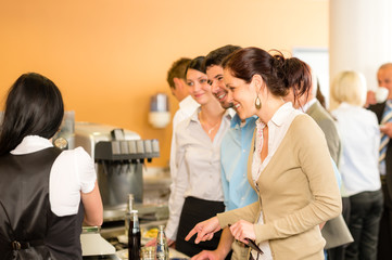 Paying at cafeteria woman cashier serve woman