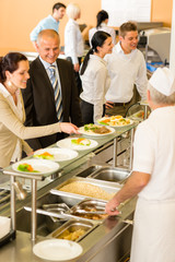 Business colleagues cook serve lunch canteen food