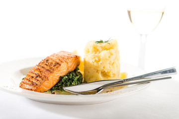 Salmon steak with spinach and mashed potatoes