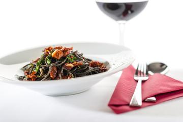 Italian style spaghetti with dried tomato, garlic