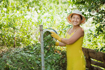 gardener composting grass