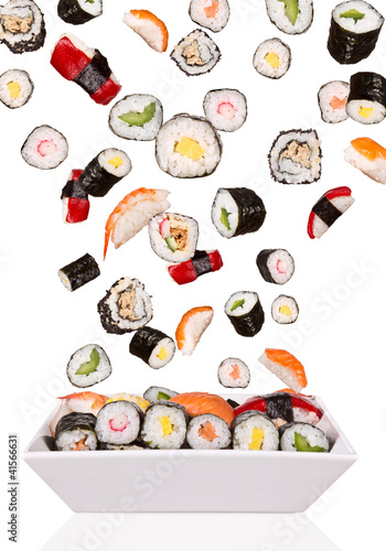 Delicious pieces of sushi, isolated on white background - 41566631