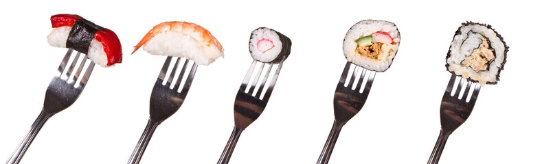 Sushi pieces on forks, isolated on white background