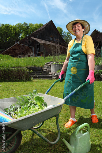 Planting vegetables in her garden