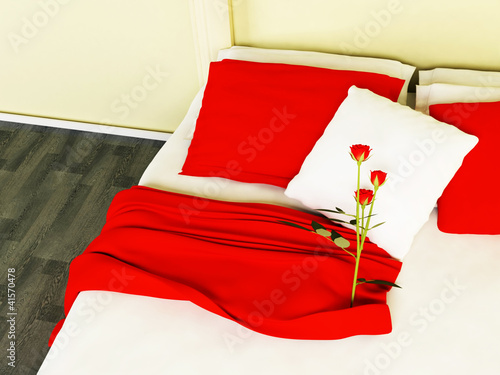 Beautiful red roses on the bed