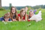 children with a chicken