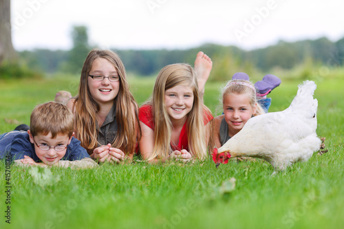 children with a chicken