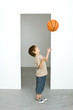 Boy throwing basketball into air
