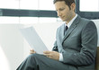 Businessman sitting and reading document