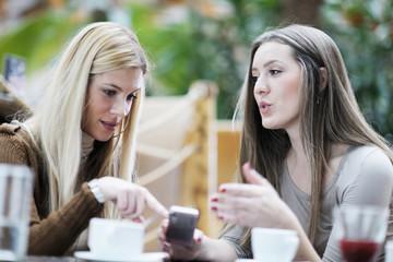 cute smiling women drinking a coffee