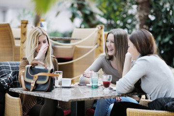 cute smiling women drinking a coffee