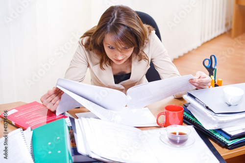 Tired woman reading papers