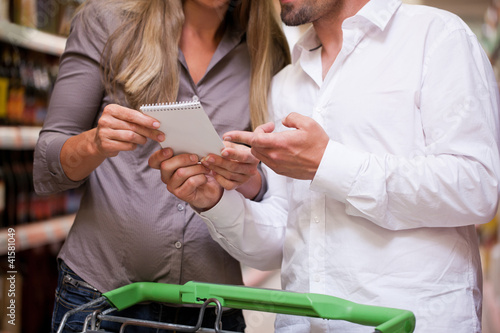 Couple Selecting Products at Supermarket