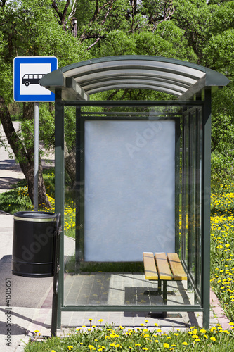 Bus stop with the ad behind the glass