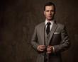 Man in grey suit.