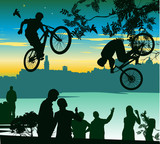 two cyclists perform a jump over the crowd of spectators poster