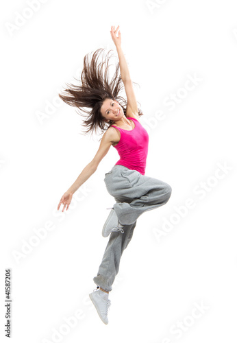 Modern teenage girl dancer dancing hip-hop and jumping