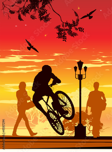 young man jumping on a bicycle in front of people - 41587294