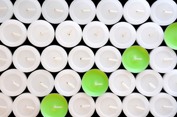 The contrast of white and green candles