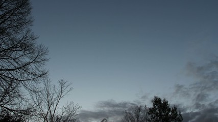 Time lapse of clouds moving across sky, the clouds get darker.
