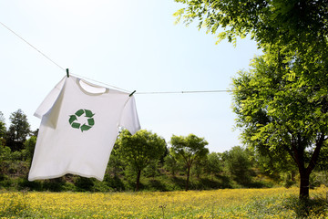 T-shirt with recycle logo drying on clothesline