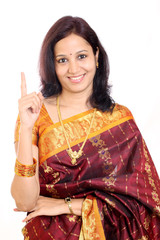 Traditional Indian woman holding her index finger up