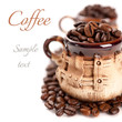 Coffee beans in a cup with the sample text
