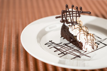 Sacher cake with whipped cream and chocolate