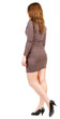 back view of going brunette girl in brown dress.
