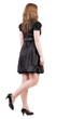 back view of going brunette woman  in black dress.