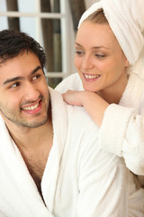Couple relaxing together after a shower