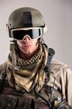 Close up portrait of soldier with mask and helmet.