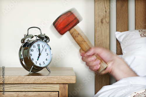 Alarm clock and sledgehammer