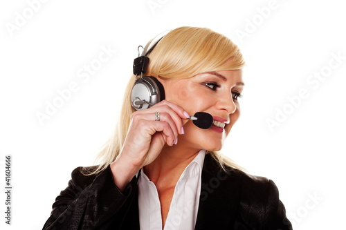 Smiling woman using headphones and mike