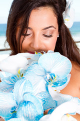 beautiful bride smelling bouquet